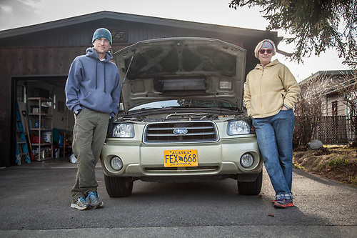 "Phyllis Ploudre and Paul Decker with their Suburu near Inlet View Elementary School, Anchorage.  ""My son borrowed my car and the check light started blinking."" (© Clark James Mishler)"