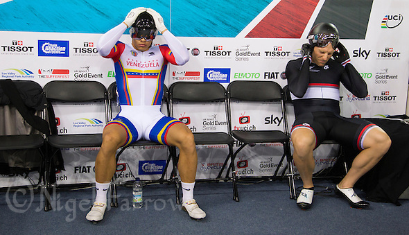 07 DEC 2014 - STRATFORD, LONDON, GBR - Hersony Canelon (VEN) (left) from Venezuela and Matthew Archibald (right) riding for HPSNZ Track Team prepare for the start of the Men's Individual Sprint bronze medal decider at the  2014 UCI Track Cycling World Cup in the Lee Valley Velo Park in Stratford, London, Great Britain (PHOTO COPYRIGHT © 2014 NIGEL FARROW, ALL RIGHTS RESERVED) (NIGEL FARROW/COPYRIGHT © 2014 NIGEL FARROW : www.nigelfarrow.com)
