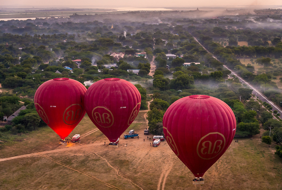 BAGAN, MYANMAR - CIRCA DECEMBER 2013: Hot air balloons ready to fly over the plains of Bagan early morning. (Daniel Korzeniewski)