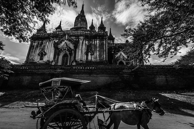A horse cart passes in front of a temple in Bagan, Myanamr (Quinn Ryan Mattingly)