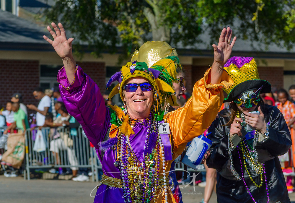 A reveler shows off his Mardi Gras Colors (note the green?) during the Joe Cain Day Procession, March 2, 2014, in downtown Mobile.