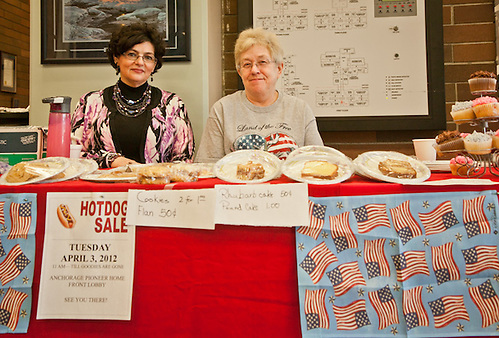"Staff member, Barb McIntire, and Volunteer, Diane Yaggi, sell hot dogs and bake goods to precenct voters in order to raise funds for the Alaska Pioneer Home ""Spirit Committee"", downtown, Anchorage. (Clark James Mishler)"