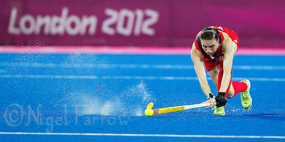 08 AUG 2012 - LONDON, GBR - Kate Walsh (GBR) of Great Britain passes the ball during the London 2012 Olympic Games women's semi final match against Argentina at the Riverbank Arena in the Olympic Park, Stratford, London, Great Britain .(PHOTO (C) 2012 NIGEL FARROW) (NIGEL FARROW/(C) 2012 NIGEL FARROW)