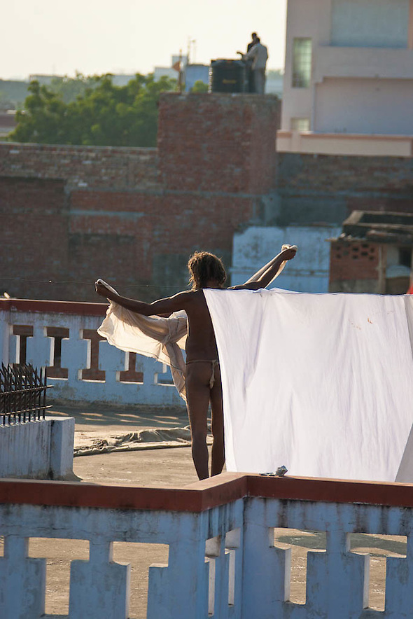 Yogi in Varanassi, India, holding his only belongings, a piece of cloth while he performs his daily routines. (Martin Herrera)