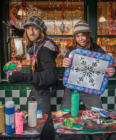 """Creative Specialist Chris Marcinkowski with his protege, Jesika Allen, while painting a store window on Lincoln Avenue in downtown Calistoga.  """"There are people who paint windows and there are artists who paint windows...I like to think of myself in the latter category.""""  mrkurisu@gmail.com (© Clark James Mishler)"""