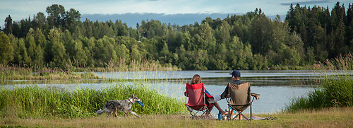 A couple relaxes on a warm evening at Anchorage's Westchester Lagoon. (© Clark James Mishler)