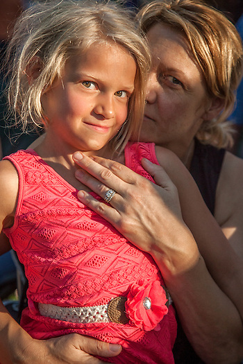 The Calistoga community attends the performance of the Santa Rosa band Kingsborough at Pioneer Park. Jonnika Benjamin and her seven year old daughter, Abby. (Clark James Mishler)