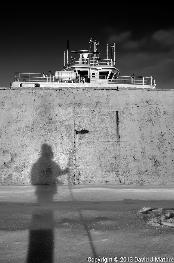 Shadow photographer fishing in Tromsø, Norway. Image taken with a Leica X2 camera (ISO 100, 24 mm, f/5.6, 1/500 sec). Raw image processed with Capture One Pro (including conversion to B&W). (David J Mathre)