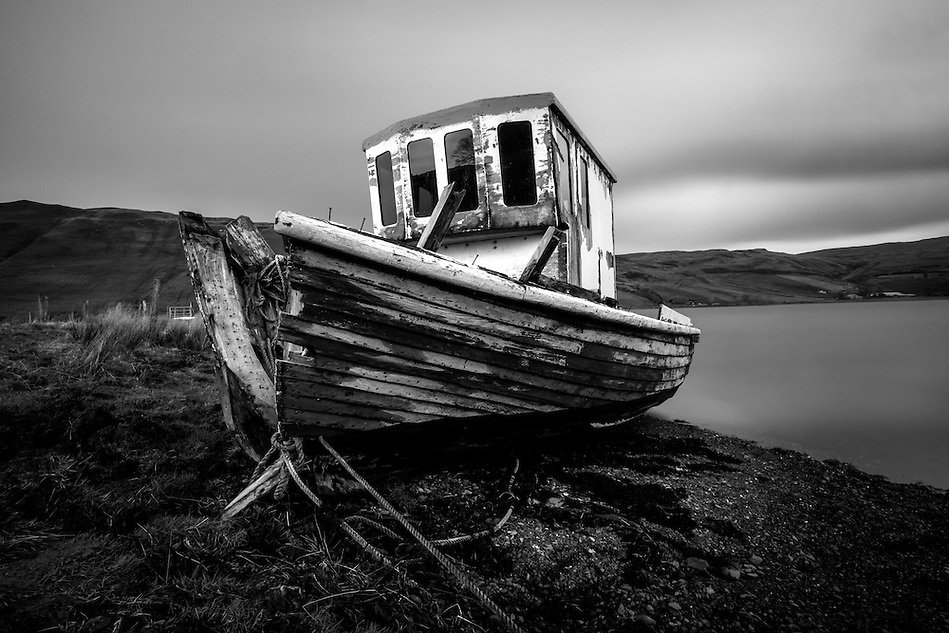 SCOTLAND - CIRCA APRIL 2016: Abandoned boat over Loch Harport near Carbost in Skye an Island in Scotland (Daniel Korzeniewski)