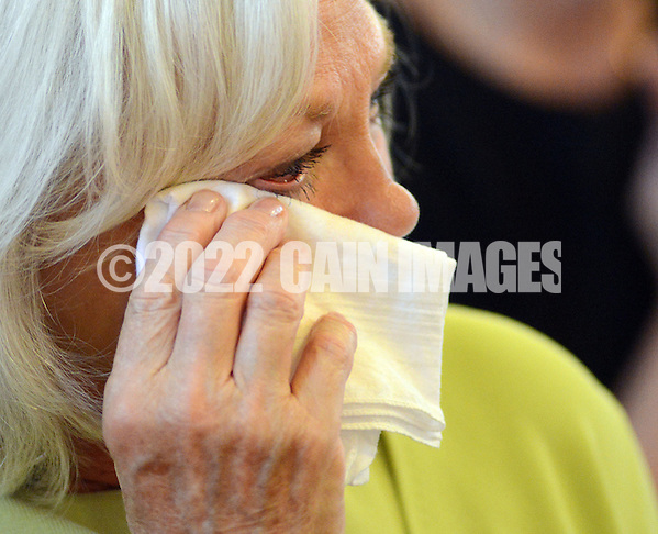 BRISTOL, PA - MAY 31:  Robyn Trunell, of Bristol, Pennsylvania wipes a tear after the closing of St. Ann's parish is announced May 31, 2014 in Bristol, Pennsylvania. (Photo by William Thomas Cain/Cain Images) (William Thomas Cain)