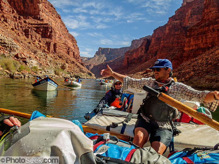"""Rafting through Marble Canyon on day 2 of 16 days boating 226 miles down the Colorado River in Grand Canyon National Park, Arizona, USA. Marble Canyon runs from Lees Ferry at River Mile 0 to the confluence with the Little Colorado River at Mile 62, which marks the beginning of the Grand Canyon. Although John Wesley Powell knew that no marble was found here when he named Marble Canyon, he thought the polished limestone looked like marble. In his words, """"The limestone of the canyon is often polished, and makes a beautiful marble. Sometimes the rocks are of many colors – white, gray, pink, and purple, with saffron tints."""" For this photo's licensing options, please inquire at PhotoSeek.com. (© Tom Dempsey / PhotoSeek.com)"""