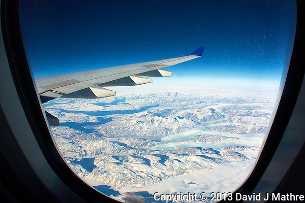Southern Greenland from 36000 feet. Image taken with a Nikon 1 V2 camera and 10 mm f/2.8 lens and Olympus FCON-T01 fisheye adapter (ISO 200, 7.5 mm, f/11, 1/640 sec). (David J Mathre)
