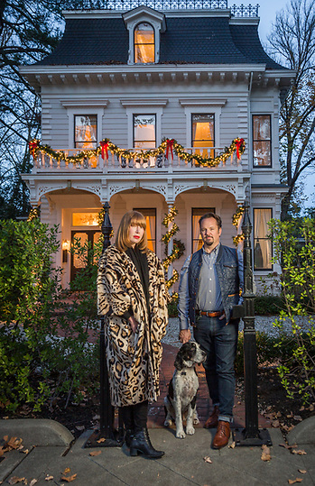 "Stylist Sabra Temple and realestate agent Paul Thienes with their dog, Teddy, pause at their front gate of their historic house on Cedar Street in Calistoga. ""We wanted to buy this house for ten years and we finally got it last January."" (Clark James Mishler)"