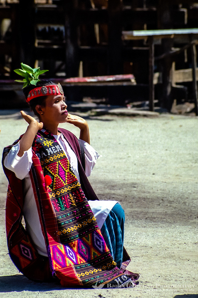 Indonesia, Sumatra. Samosir. Simanindo on the northern tip of Samosir is the cultural center of Samosir, with a museum. Batak dance performance. Batak dancer wearing traditional Batak textiles. (Photo Bjorn Grotting)