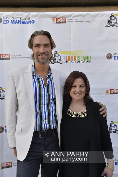 Bellmore, New York, USA. July 16, 2015. Actor LUKAS HASSEL and DEBORAH MARKOWITZ, Nassau County Film Commissioner, are on the Red Carpet at the 18th Annual LIIFE Awards Ceremony, at the Bellmore Movies. Markowitz is the director of of the Long Island International Film Expo. (Ann Parry/Ann Parry, ann-parry.com)