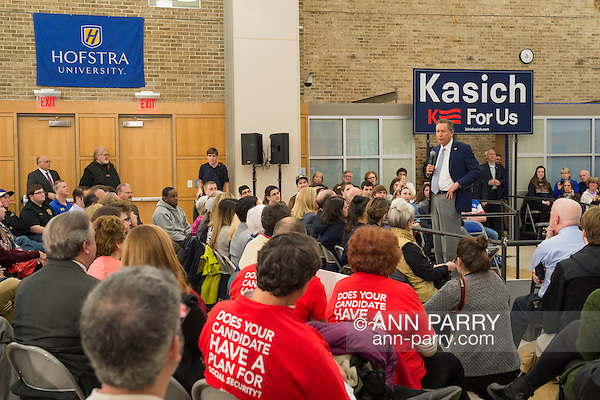 Hempstead, New York, USA. April 4, 2016. JOHN KASICH, Republican presidential candidate and governor of Ohio, speaks at the Town Hall he's hosting at Hofstra University David Mack Student Center in Long Island. Audience includes senior citizens from Long Island AARP (American Association of Retired Persons) wearing red shirts with message 'Does Your Candidate Have A Plan For Social Security?' on back, . The New York primary is April 19, and Kasich is the first of the three GOP presidential candidates to campaign in Nassau and Suffolk Counties, and is in third place in number of delegates won. (Ann Parry/Ann Parry, ann-parry.com)