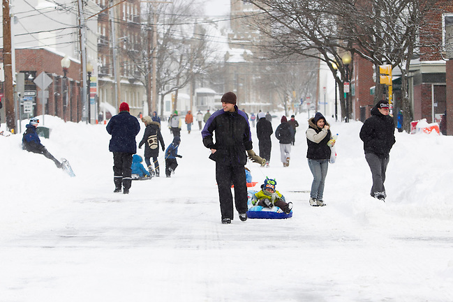 Pedestrians make their way down College Avenue in Davis Square in Somerville, Massachusetts, U.S., after Winter Storm Nemo dropped about 2 feet of snow overnight on Saturday, Feb. 9, 2013. Mass. Gov. Deval Patrick imposed a road travel ban until road conditions improve. Kelvin Ma/Bloomberg