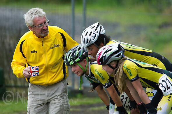 11 AUG 2013 - BIRMINGHAM, GBR - John E. Fry, former British international and chairman of Birmingham Wheels Roller Speed Club, checks on his team after their win in the Pupil and Cadet Girls 3000m Relay at the Federation of Inline Speed Skating 2013 British Outdoor Championships at Birmingham Wheels Park in Birmingham, West Midlands, Great Britain (PHOTO COPYRIGHT © 2013 NIGEL FARROW, ALL RIGHTS RESERVED) (NIGEL FARROW/COPYRIGHT © 2013 NIGEL FARROW : www.nigelfarrow.com)