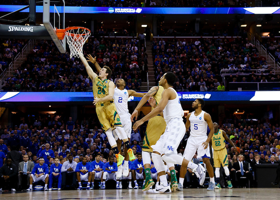 Mar 28, 2015; Cleveland, OH, USA; Notre Dame Fighting Irish guard/forward Pat Connaughton (24) goes to the basket on Kentucky Wildcats guard Aaron Harrison (2) in the finals of the midwest regional of the 2015 NCAA Tournament at Quicken Loans Arena. Mandatory Credit: Rick Osentoski-USA TODAY Sports (Rick Osentoski/Rick Osentoski-USA TODAY Sports)