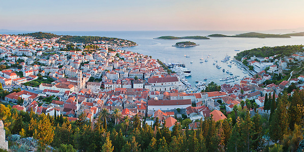 Panoramic photo of Hvar Town at sunset taken from the Spanish Fort (Tvrdava Spanjola), Hvar Island, Croatia, Europe. This panoramic photo of Hvar Town and Harbour was taken at sunset from the Spanish Fort (Tvrdava Spanjola), known as Fortica. From its position high up on a hill above Hvar Town, it provides the best views over Hvar Town and Island. It is easily worth the walk up to the Spanish Fort, especially at sunset.