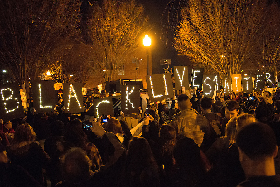 11/25/14 – Medford/Somerville, MA – Protesters hold up signs during the Indict America rally in Dudley Square on November 25th, 2014. (Nicholas Pfosi / The Tufts Daily) (Nicholas Pfosi / The Tufts Daily)