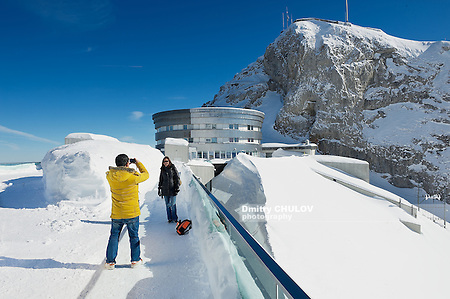 LUCERN, SWITZERLAND - FEBRUARY 21, 2012: Unidentified tourists make travel photo at the terrace on top of the Pilatus mountain in Lucern, Switzerland. (Dmitry Chulov)
