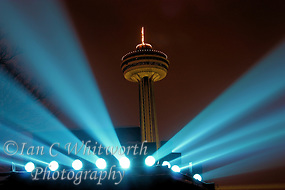 Night view of the Skylon tower at Niagara Falls beween the spotlights for the falls (Ian C Whitworth)