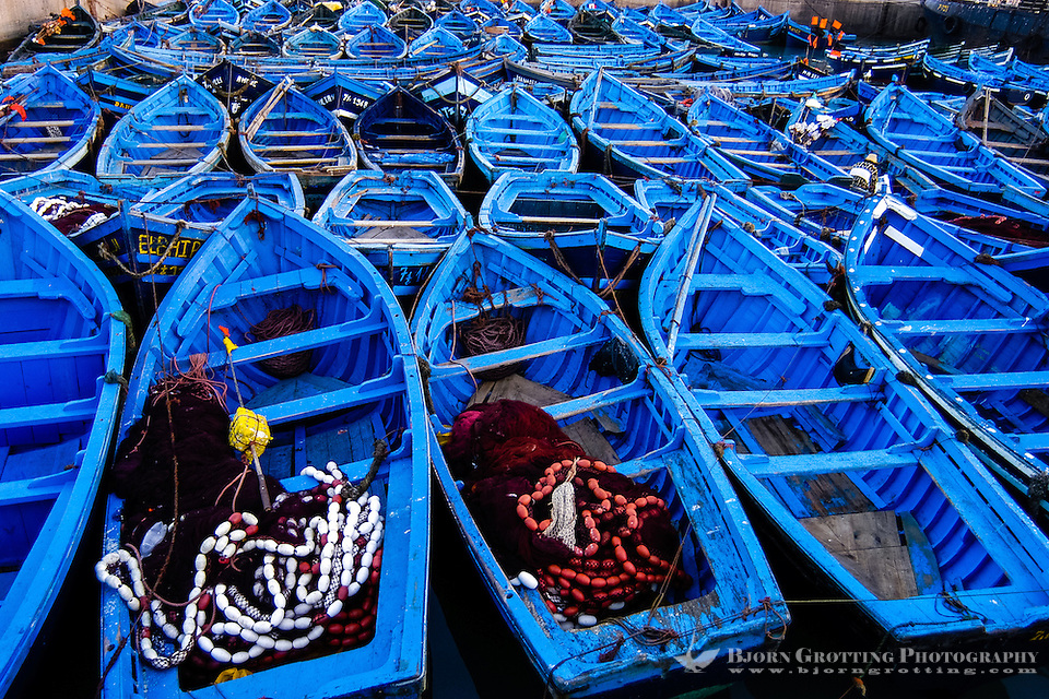 Colourful blue fishing boats. Essaouira is a city on the Moroccan Atlantic coast. Fortress walls originally enclosed the entire city. (Bjorn Grotting)
