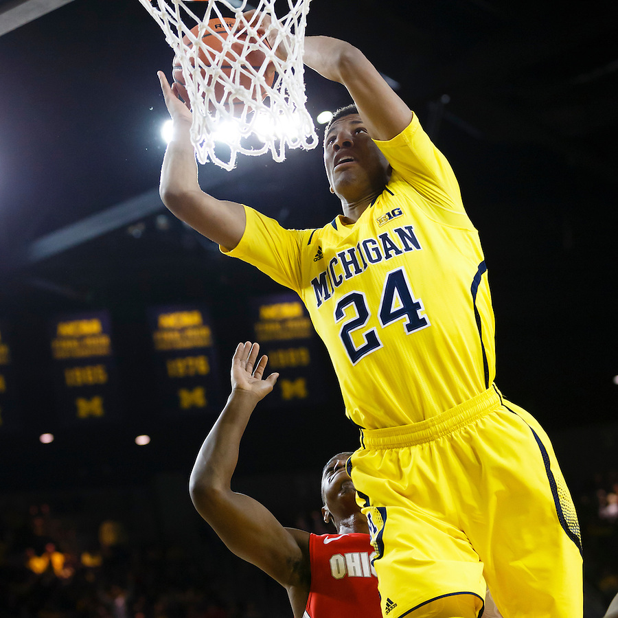 Feb 22, 2015; Ann Arbor, MI, USA; Michigan Wolverines guard/forward Aubrey Dawkins (24) attempts to dunk  in the first half against the Ohio State Buckeyes at Crisler Center. Mandatory Credit: Rick Osentoski-USA TODAY Sports (Rick Osentoski/Rick Osentoski-USA TODAY Sports)