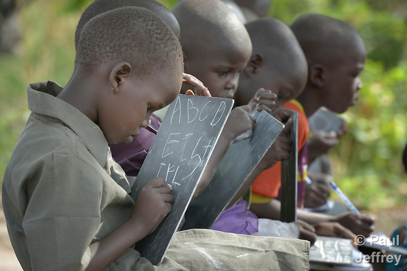 A girl writes the alphabet on a chalkboard at the Loreto Primary School in Rumbek, South Sudan. The school is run by the Institute for the Blessed Virgin Mary--the Loreto Sisters--of Ireland. (Paul Jeffrey)
