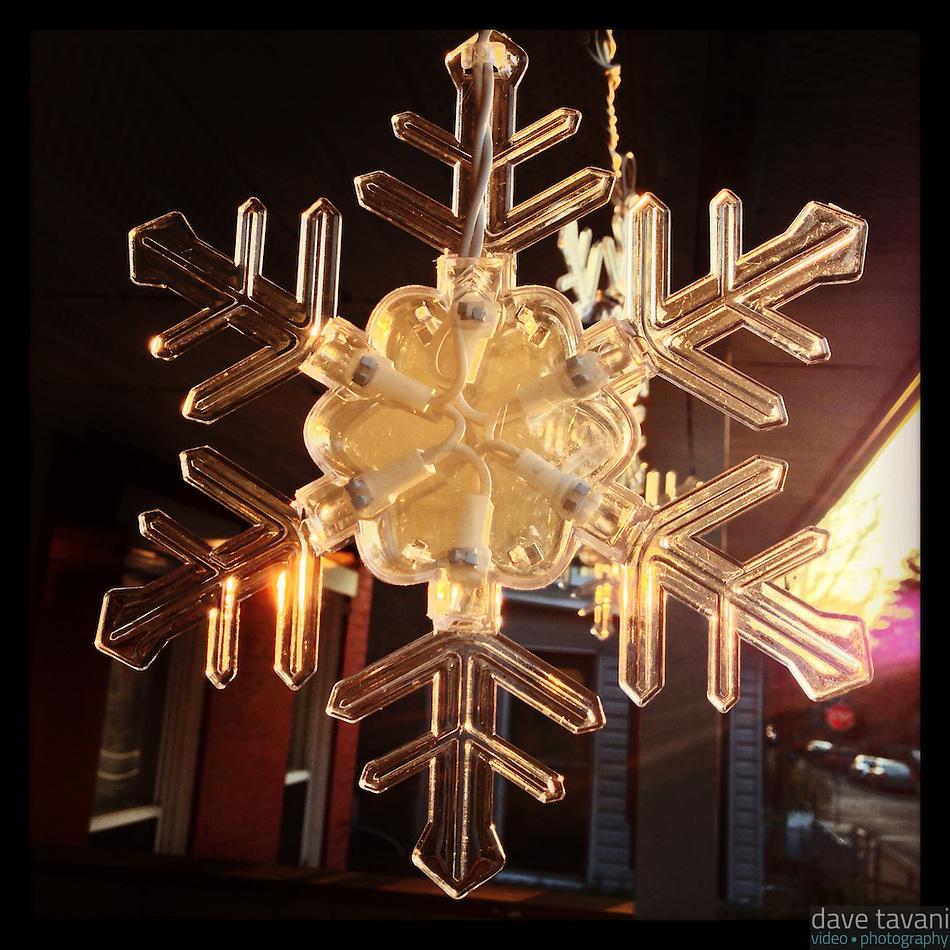 The sun illuminates a decorative snowflake on my neighbor's front porch on January 6, 2013. (Dave Tavani)