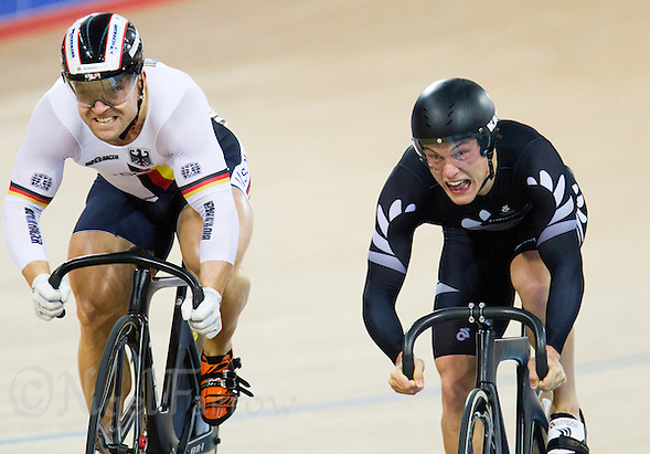 07 DEC 2014 - STRATFORD, LONDON, GBR - Robert Forstemann (GER) (left) from Germany and Sam Webster (NZL) of New Zealand race for the finish line during the Men's Individual Sprint 1/8 finals at the 2014 UCI Track Cycling World Cup in the Lee Valley Velo Park in Stratford, London, Great Britain (PHOTO COPYRIGHT © 2014 NIGEL FARROW, ALL RIGHTS RESERVED) (NIGEL FARROW/COPYRIGHT © 2014 NIGEL FARROW : www.nigelfarrow.com)