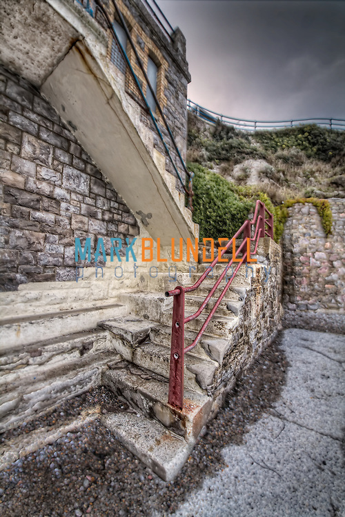 Red and Blue hand rails on weathered steps at Plymouth Hoe (Mark Blundell)