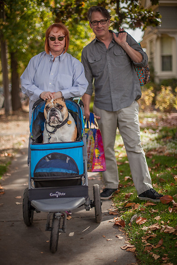 Saint Helena residents Leslie and Christopher with their English bull dog, Edward Bear,  leave Calistoga's Saturday Market.  lross-lentz@comcast.net (© Clark James Mishler)
