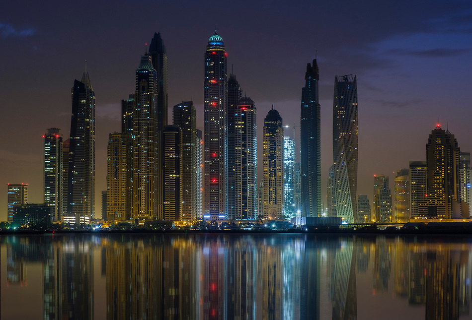UNITED ARAB EMIRATES, DUBAI - CIRCA JANUARY 2017: Dubai Marina cityscape and skyscrapers as seen from Palm Jumeirah at dusk. (Daniel Korzeniewski)