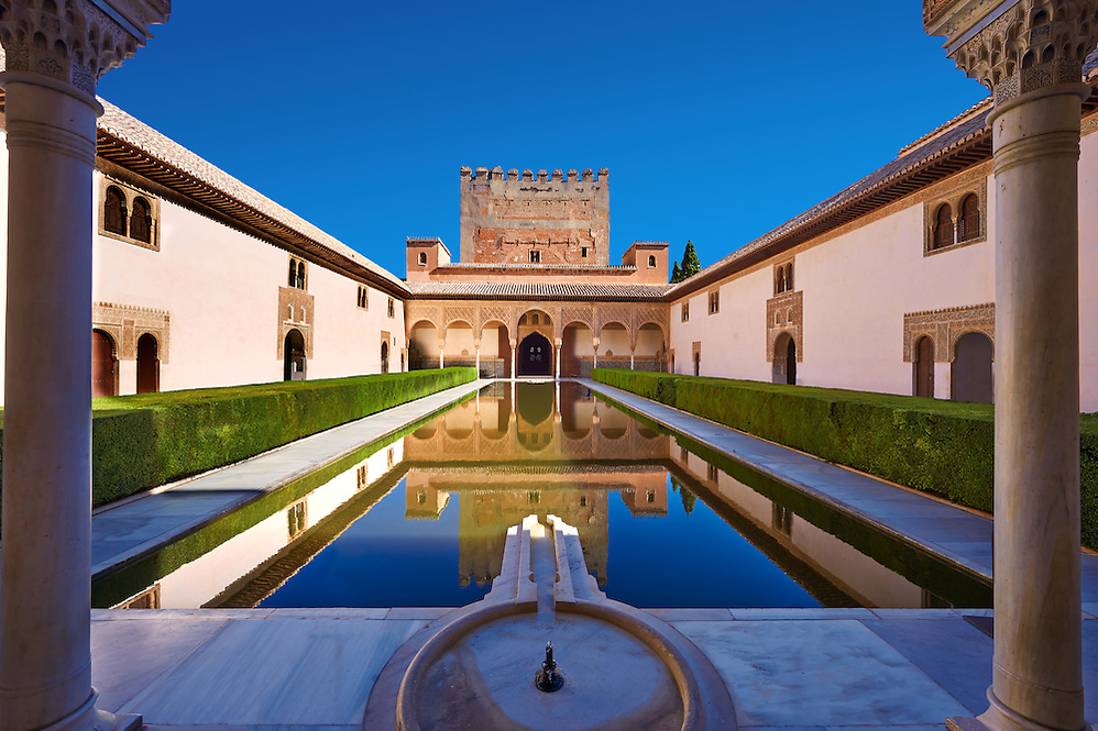 Arabesque Moorish architecture and pond of the  Court of the Myrtles  of the Palacios Nazaries,  Alhambra. Granada, Andalusia, Spain. (Paul E Williams)
