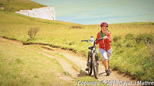 Walking a Bicycle on a Trail. Above the White Cliffs of Dover, England. Image taken with a Leica V-Lux 6 camera (ISO 100, 17.7 mm, f/2.8, 1/1600 sec). Semester at Sea Spring 2013 Enrichment Voyage. (David J Mathre)