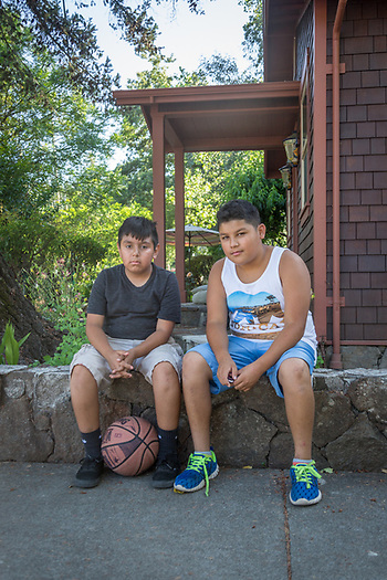 """We're going into the 7th grade but we're not freaked out...we've got friends there.""   -Twelve year old friends Ruben Gallarado and Oscar Maldonado rest at the corner of Third and Washington Streets after an afternoon of basketball in Calistoga. (Clark James Mishler)"
