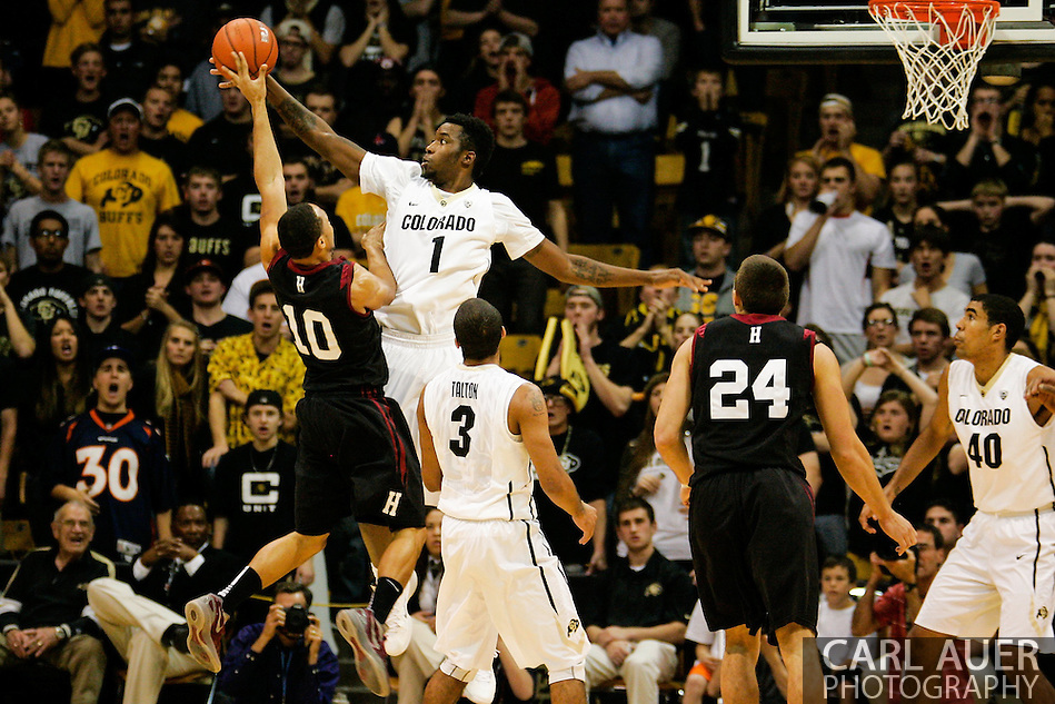 November 24th, 2013:  Colorado Buffaloes redshirt freshman forward Wesley Gordon (1) blocks a shot attempt by Harvard Crimson senior guard Brandyn Curry (10) in the second half of the NCAA Basketball game between the Harvard Crimson and the University of Colorado Buffaloes at the Coors Events Center in Boulder, Colorado (Carl Auer/ZUMAPRESS.com)