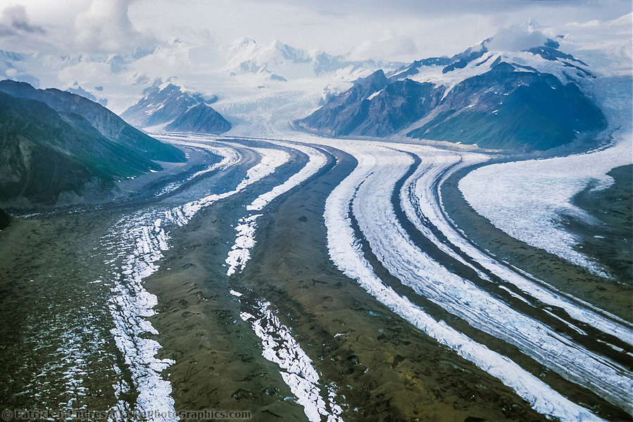 Aerial view of long glacier with multiple medial moraines (black lines of rock in the glacier) Wrangell St. Elias National Park, Alaska. (Patrick J. Endres / AlaskaPhotoGraphics.com)