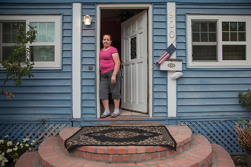 "Elvia Maldonado with her daughter, Cecilia, at their front door in Calistoga, California.  ""My mother moved here from Mexico15 years ago...she loves Calistoga because it is so quiet.  My mother has never learned to speak English.""  -Cecilia Maldonado  cecimaldonado56@yahoo.com (© Clark James Mishler)"