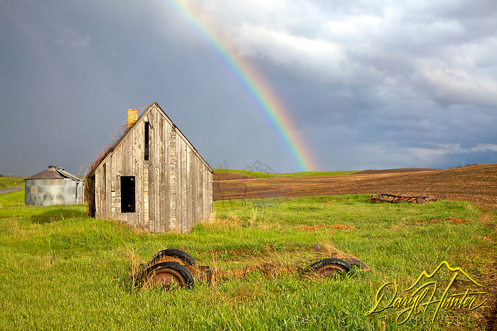 Rainbow over old homestead (Daryl Hunter's &quot;The Hole Picture&quot;  Daryl L. Hunter has been photographing the Yellowstone Region since 1987, when he packed up his view camera, Pentex 6X7, and his 35mms and headed to Jackson Hole Wyoming. Besides selling photography Daryl also publ/Daryl L. Hunter,)