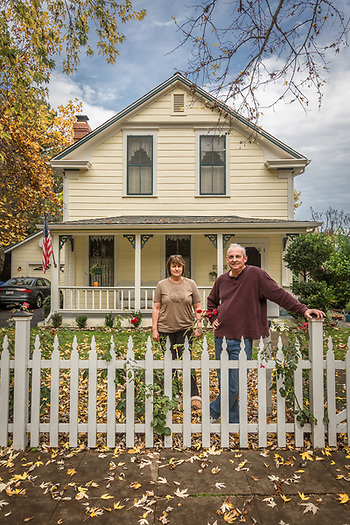 """This was built in 1873 and it was the first house on this side of the creek. We bought it twenty four years ago... when I was pregnant with Lauren. Our daughters were completely freaking out during the fires...they were afraid of loosing our family home. Each time the girls come home, the house fills up with friends."" -Karen and Jeff Maxfield stand in front of their house on Cedar Street in Calistoga. (Clark James Mishler)"