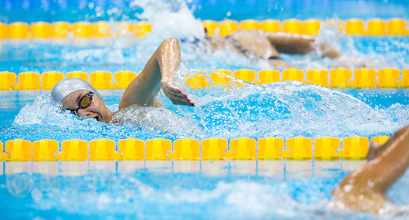 12 AUG 2012 - LONDON, GBR - Adrienn Toth (HUN) (left) of Hungary during her women's London 2012 Olympic Games Modern Pentathlon swimming heat at the Aquatic Centre in the Olympic Park, in Stratford, London, Great Britain (PHOTO (C) 2012 NIGEL FARROW) (NIGEL FARROW/(C) 2012 NIGEL FARROW)