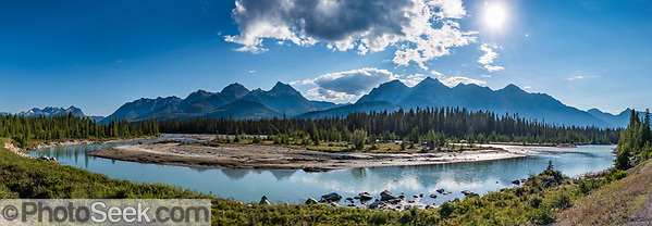 The Canadian Rocky Mountains reflect in the Kootenay River, in Kootenay National Park, British Columbia, Canada. (© Tom Dempsey / PhotoSeek.com)