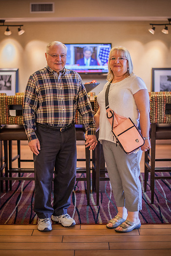 "Retired elementary school principals John Luciani and Barrett Jackson at the Hampton Inn, Anthem, AZ  ""We're here for the big car show."" (© Clark James Mishler)"