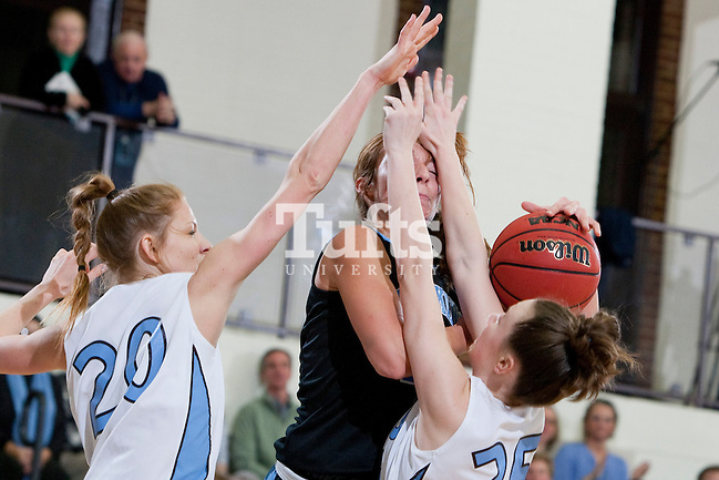 03/03/2012 - Medford, Mass. - Johns Hopkins forward Alex Vassila gets her shot blocked by Tufts guard Liz Moynihan, A14, in Tufts' 55-46 win over Johns Hopkins in the second round of the NCAA Division III Women's Basketball Championship at Tufts University's Cousens Gymnasium on March 3, 2012. (Kelvin Ma/Tufts University)