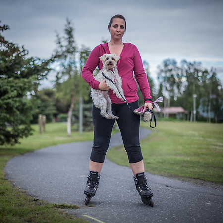 "Special education teacher Terri Dreeszen and her dog Pebbles on the bike trail near Westchester Lagoon, Anchorage  ""She always keeps up…and sometimes she actually pulls!""  tdreezen@gmail.com (© Clark James Mishler)"