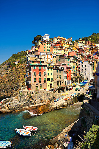 Photo of the colorful houses of the fishing port of Riomaggiore, Cinque Terre National Park, Liguria, Italy (Paul E Williams)