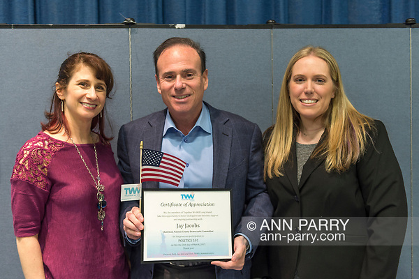 Wyandanch, New York, USA. March 26, 2017. At center, JAY JACOBS, Chairman of Nassau County Democratic Committee, holds Certificate of Appreciation and American Flag presented by, (L) BETH MEHRTENS McMANUS, and (R) SUE MOLLER, two administrators of Together We Will Long Island. Jacobs spoke at Politics 101 event, the first of a series of activist training workshops for members of TWW LI, the L.I. affilitate of TWW. (Ann Parry/Ann Parry, ann-parry.com)